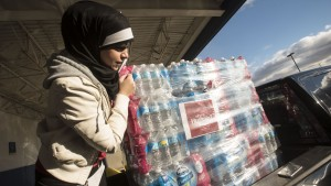 who is hussain donate water to michigan flint
